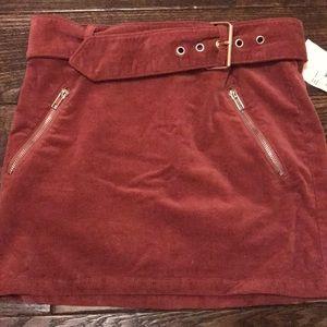 Dark red buckle mini skirt